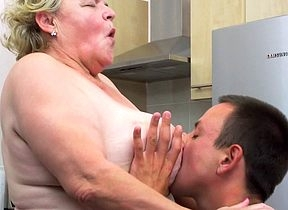 Curvy granny sucking coupled with fucking a equally younger toff in her kitchen