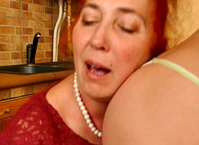Hot babe fisting a mature lesbian in the Nautical galley
